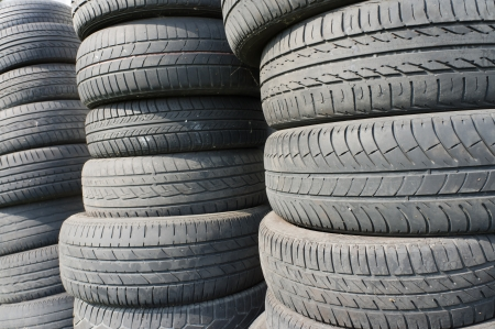 Stacks of used car tires photo