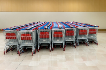 shopping trolleys: shopping trolleys stands at the supermarket Stock Photo