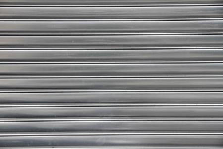 rolling: metal security roller door background Stock Photo