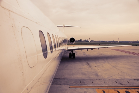 aircraft take off: airplane parked in airport waiting for boarding passengers