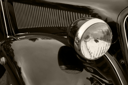 car detail: Head lamp of a classic toned in sepia car