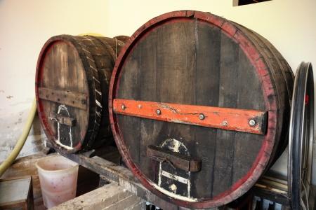 tun: wooden wine barrels in old cellar Stock Photo