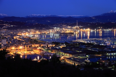 View of La Spezia harbor at night. Liguria, Italy photo