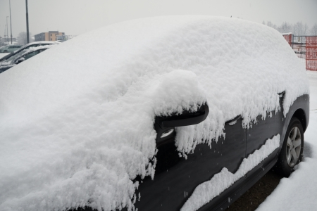 parked car covered with snow in winter photo