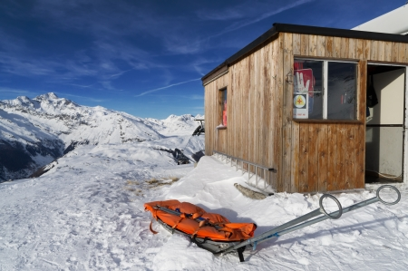 skiing accident: alpine rescue on high mountain in winter with emegency sled