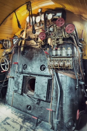 Controls in the cabin of a vintage steam train locomotive photo