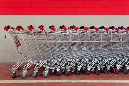 super market: row of shopping trolleys or carts in supermarket