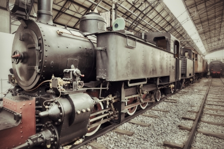 Old retro steam train locomotive in station