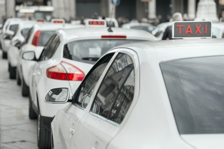 italian car: row of white taxi in Milan, Italy