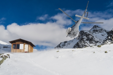 rescue service: Helicopter mountain rescue service in winter, on italian alps Stock Photo
