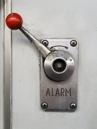 lever: Alarm lever or emergency brake on a train