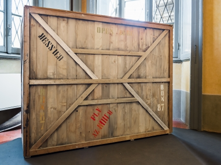 packaging industry: wooden crate in warehouse, museum or empty room Editorial