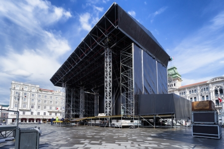 show cases: mounting a huge concert stage in city square Stock Photo