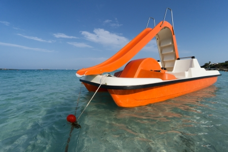 pedal: orange pedalo with water slide