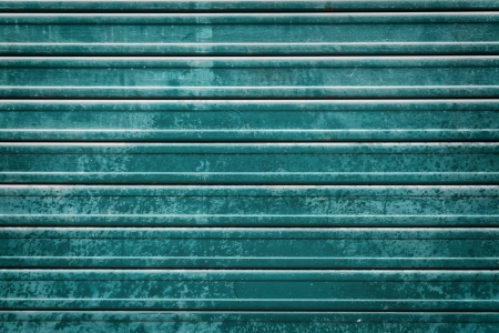 teal roller door grunge background photo