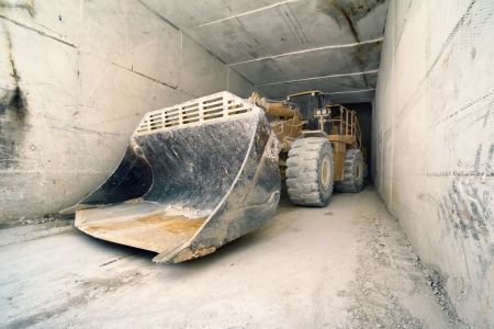 Colonata (Carrara), Italy, bulldozer in marble quarries tunnel
