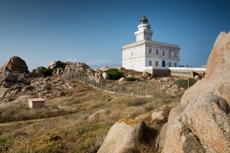 White lighthouse at Capo Testa, Sardinia, Italy photo