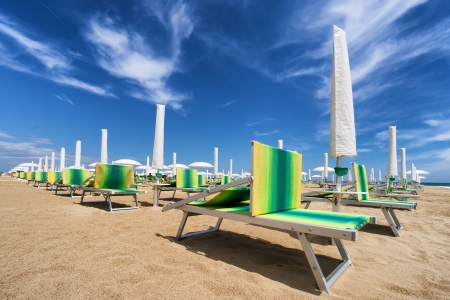 emilia romagna: sunbed and beach umbrella on riviera romagnola