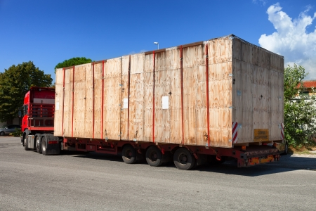 wooden crate on oversize load  truck shipment photo