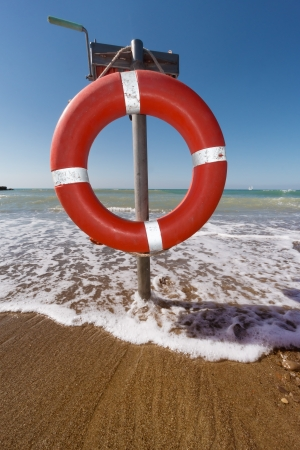 beach buoy: insurance concept, life saver on a pole  Stock Photo