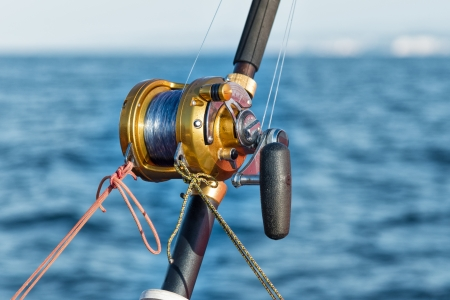 fishing reel and pole in boat during big game Stock Photo - 22900416