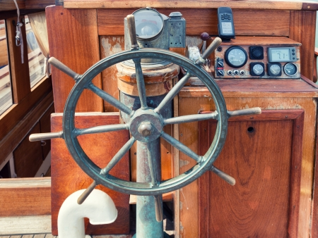 Helm or steering wheel  of an old ship photo