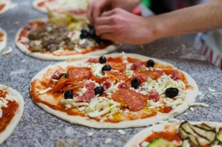 prepare raw pizza in pizzeria