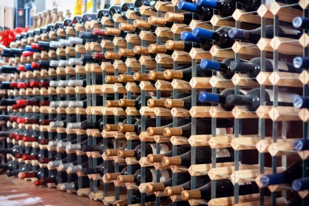 colorful wine bottles in rack on the cellar Stock Photo