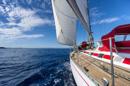 Yacht sailing in the sea in sunny day photo