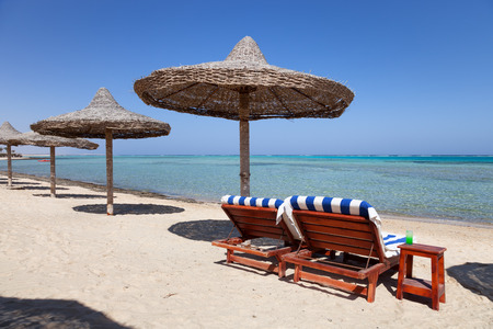 alam: Marsa Alam beach with the two beach beds and umbrella, Egypt