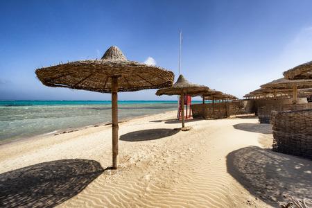 alam: Marsa Alam beach with row of umbrella, Egypt Stock Photo