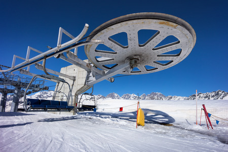 ski lift chair station on slope in mountain Stock Photo