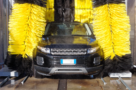 dirty car: Automobile through a car wash machine