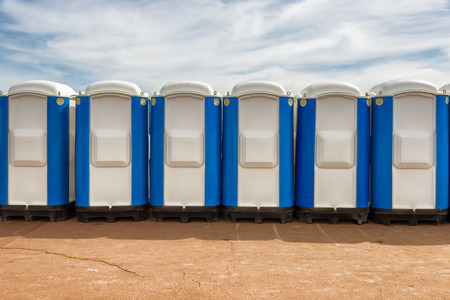 row of portable public wc in the street