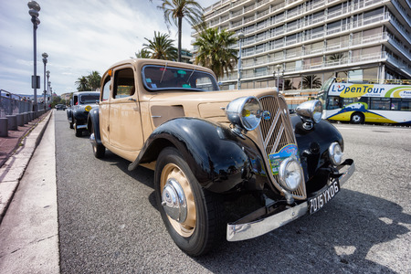 NICE, FRANCE - APRIL 26, 2014: A classic Citroen car during the 11th CitroLevens parade, here on the promenade des angles in Nice.