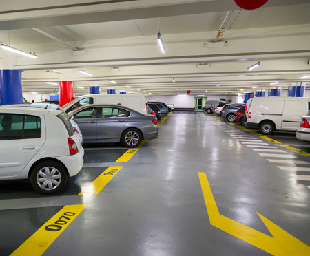 cars parking: Underground garage, urban parking lot  Stock Photo