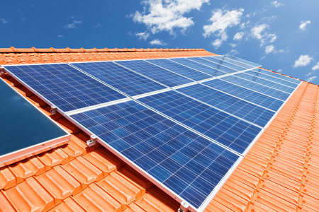 Green renewable energy with photovoltaic solar panels on roof Archivio Fotografico