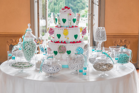 Dessert table with cake and candy for a wedding or party photo