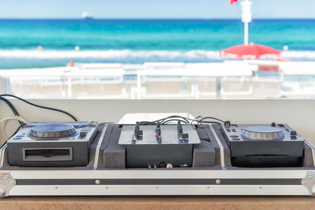 sumer party: dj console on the beach photo