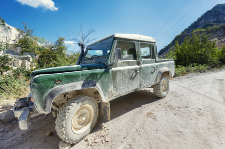 4x4: Old dirty off-road car in mountain
