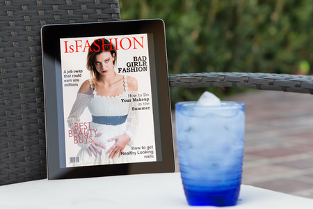 fake fashion magazine cover on a tablet in the garden Stock Photo