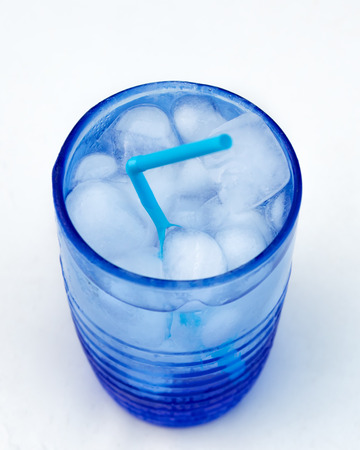 ice cubes and water on a blue glass photo