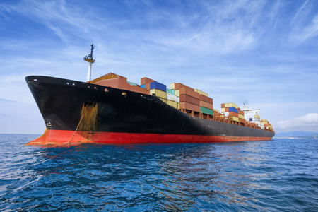 international shipping: commercial cargo ship carrying containers