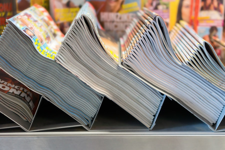 publish: piles of magazines in the kiosk