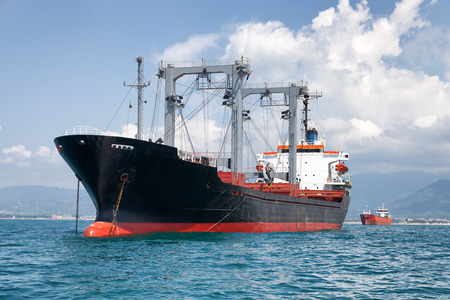 commercial cargo ship on ocean Stock Photo