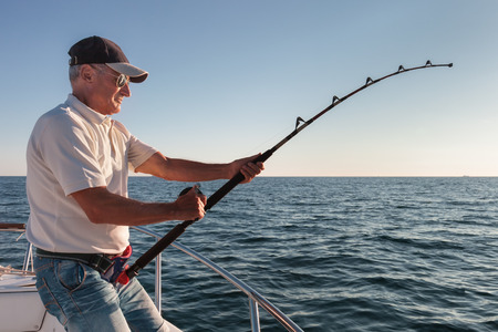 huge: fisherman fishing from the boat Stock Photo