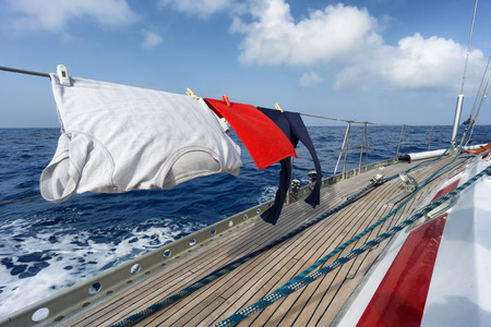 funny hanging clothes on the sail boat photo