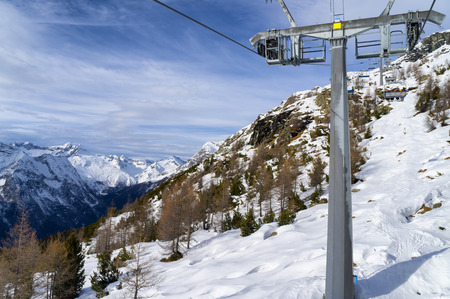 chairlift: Mountain slopes and chairlift in winter on a sunny day