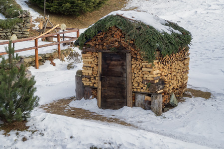 woodshed: woodshed hut decorated with wood logs