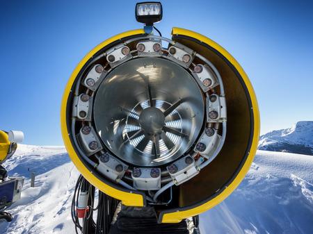 slope: snow gun on mountain ski slope